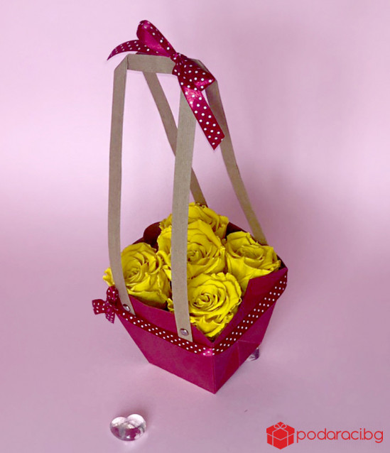 Basket with yellow everlasting roses