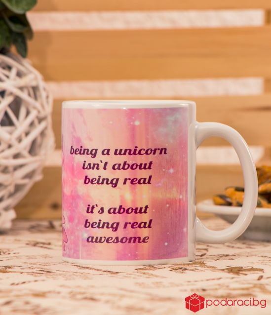 A cup with a sleeping unicorn