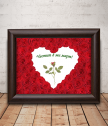 A real red rose framed for March 8