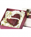 A box with a lace chocolate heart